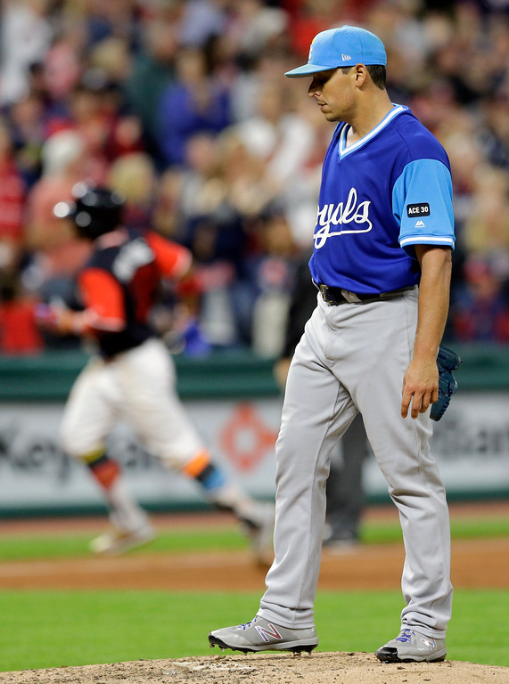 . Kansas City Royals starting pitcher Jason Vargas, right, waits for Cleveland Indians\' Francisco Lindor to run the bases on a two-run home run during the fifth inning of a baseball game, Friday, Aug. 25, 2017, in Cleveland. Giovanny Urshela scored on the play. (AP Photo/Tony Dejak)
