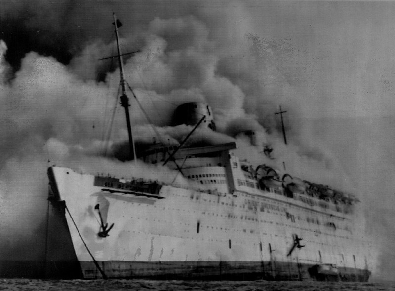 . Smoke billows from the former luxury liner Queen Elizabeth, Sunday, while anchored in Hong Kong harbor. The Queen Elizabeth, now named Seawise University, was being renovated for use as a combination floating University and cruise ship.