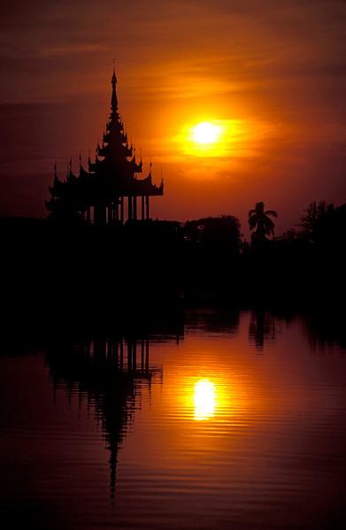 Sunset over Ornate Pagoda at Mandalay Fort Palace, Burma