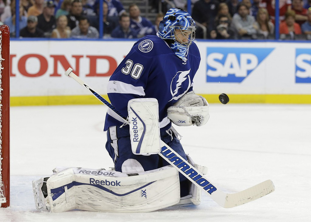 . Tampa Bay Lightning goalie Ben Bishop (30) makes a save on a shot by the Detroit Red Wings during the first period of Game 7 of a first-round NHL Stanley Cup hockey playoff series Wednesday, April 29, 2015, in Tampa, Fla. (AP Photo/Chris O\'Meara)