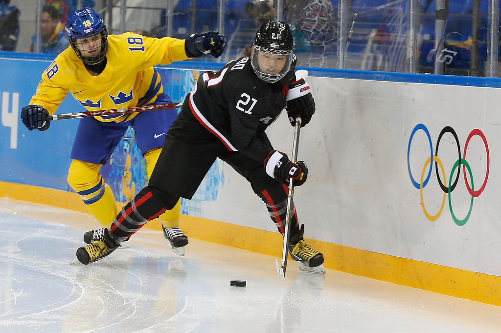 . Hanae Kubo of Japan ames control of the puck from Anna Borgqvist of Sweden during second period of the 2014 Winter Olympics women\'s ice hockey game at Shayba Arena, Sunday, Feb. 9, 2014, in Sochi, Russia. (AP Photo/Petr David Josek)