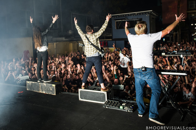 Spencer Chamberlain, Timothy McTague, and Christopher Dudley of Underoath greet the crowd during their final show on January 26, 2013 at Jannus Live in St. Petersburg, Florida
