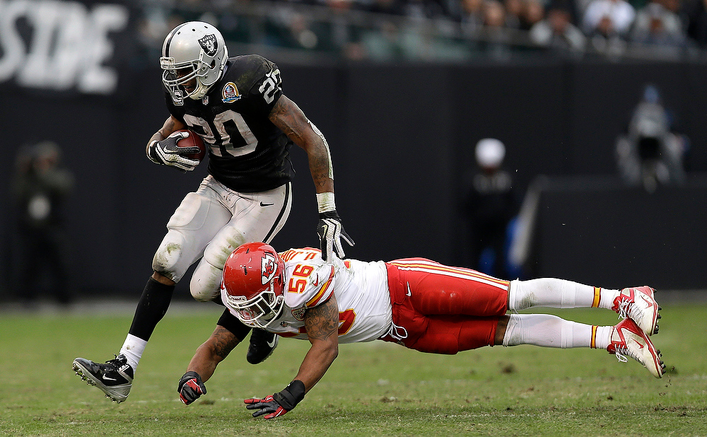 . Oakland Raiders running back Darren McFadden (20) runs against Kansas City Chiefs inside linebacker Derrick Johnson (56) during the second quarter of an NFL football game in Oakland, Calif., Sunday, Dec. 16, 2012. (AP Photo/Marcio Jose Sanchez)