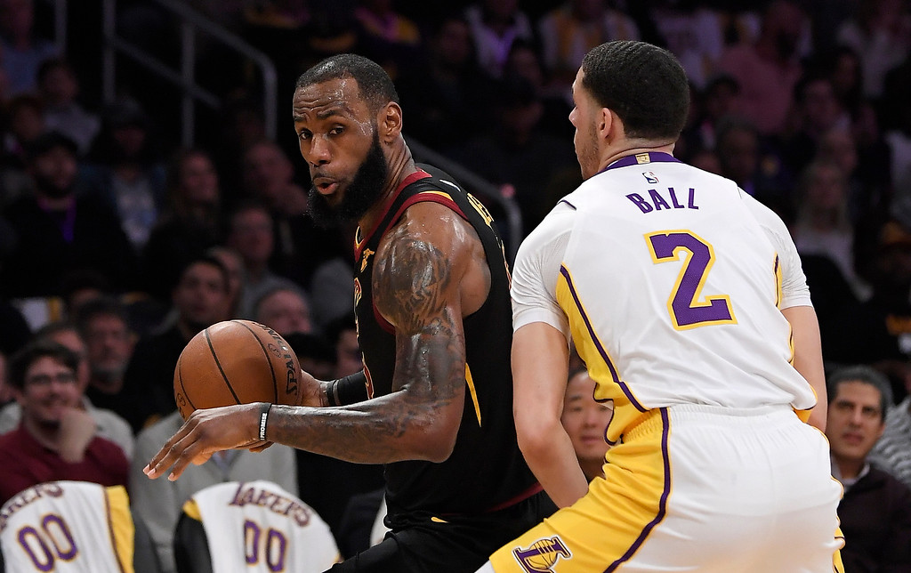 . Cleveland Cavaliers forward LeBron James, left, tries to get past Los Angeles Lakers guard Lonzo Ball during the first half of an NBA basketball game, Sunday, March 11, 2018, in Los Angeles. (AP Photo/Mark J. Terrill)
