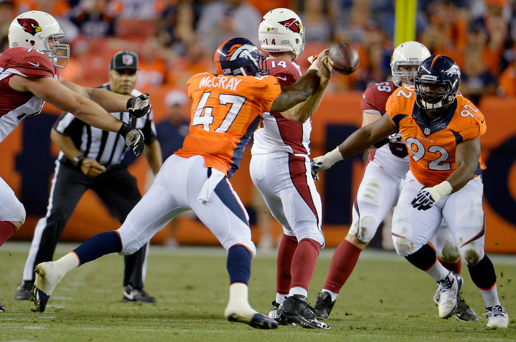 . Lerentee McCray (47) of the Denver Broncos applies pressure to Ryan Lindley (14) of the Arizona Cardinals during the last pre-season game of the season at Sports Authority Field at Mile High. August 29, 2013 Denver, Colorado. (Photo By Joe Amon/The Denver Post)