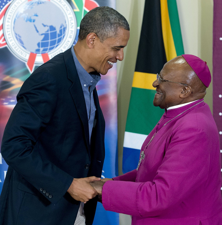 ". US President Barack Obama chats with Desmond Tutu following a tour of the Desmond Tutu HIV Foundation Youth Centre in Cape Town, South Africa, on June 30, 2013. Desmond Tutu on Sunday hailed Nelson Mandela as an ""incredible, incredible person\"" who was still uniting South Africans from the hospital bed where he is battling for his life.  SAUL LOEB/AFP/Getty Images"