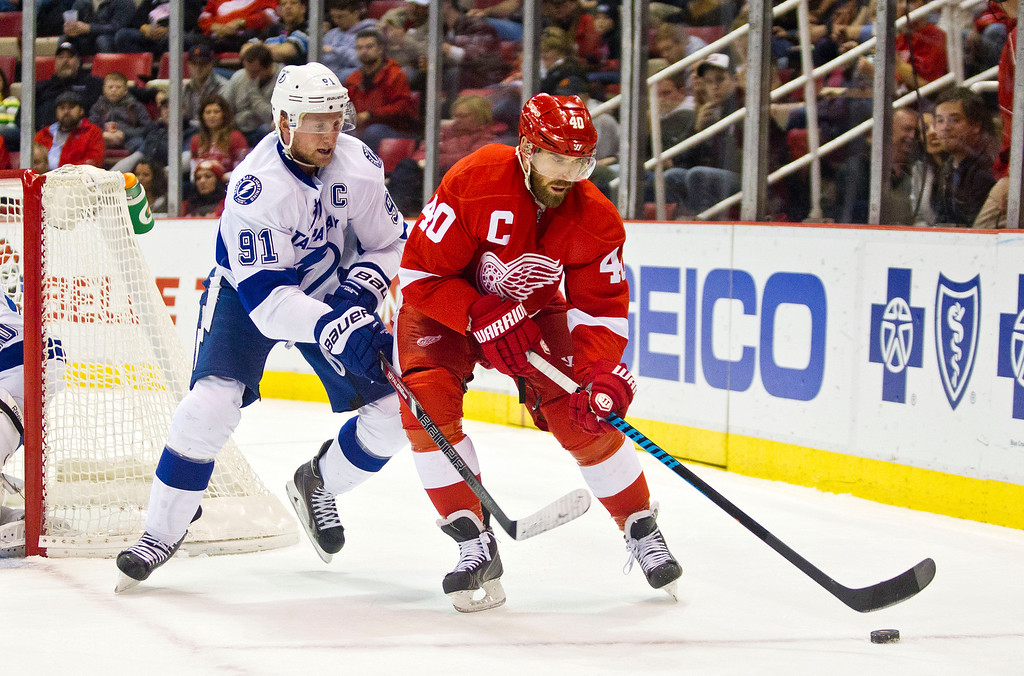 . Tampa Bay Lightning forward Steven Stamkos (91) defends Detroit Red Wings forward Henrik Zetterberg (40), of Sweden, during the first period of an NHL hockey game in Detroit on Sunday, Nov. 9, 2014. (AP Photo/Tony Ding)