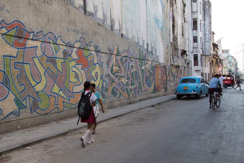 Some of the city streets include wall murals or other types of art.
