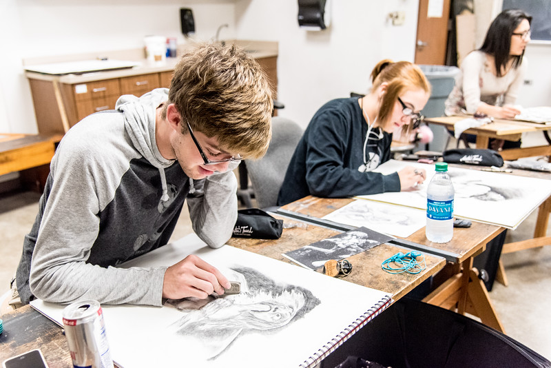 Jared Ulch works on his replicating technique during Drawing I class.