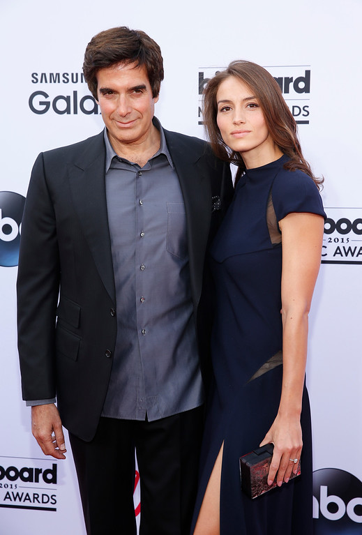 . David Copperfield, left, and Chloe Gosselin arrive at the Billboard Music Awards at the MGM Grand Garden Arena on Sunday, May 17, 2015, in Las Vegas. (Photo by Eric Jamison/Invision/AP)