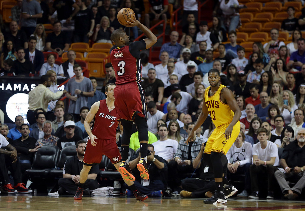 . Miami Heat guard Dwyane Wade (3) shoots over Cleveland Cavaliers center Tristan Thompson (13) during the first half of an NBA basketball game, Saturday, March 19, 2016, in Miami. (AP Photo/Lynne Sladky)