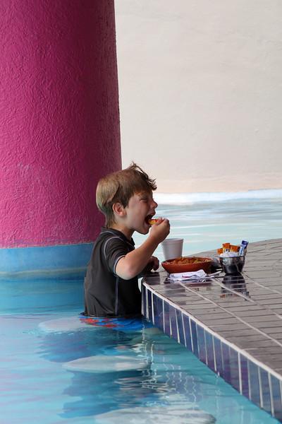 Harry found nirvana: the Westin's pool had a swim-up snack bar.