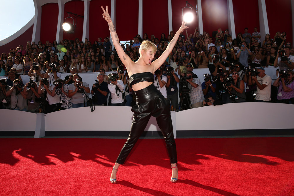 . Singer Miley Cyrus attends the 2014 MTV Video Music Awards at The Forum on August 24, 2014 in Inglewood, California.  (Photo by Christopher Polk/Getty Images for MTV)