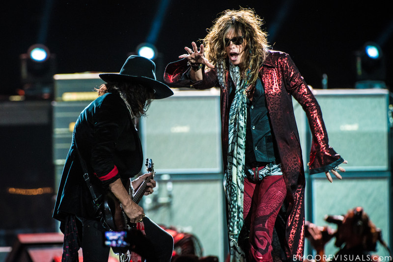 Joe Perry and Steven Tyler of Aerosmith perform on December 11, 2012 during The Global Warming Tour at Tampa Bay Times Forum in Tampa, Florida