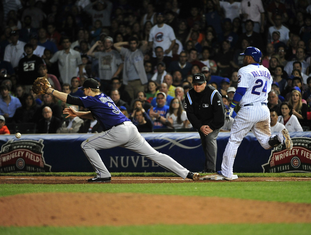 . CHICAGO, IL - JULY 30: Luis Valbuena #24 of the Chicago Cubs beats out an infield single as Justin Morneau #33 of the Colorado Rockies takes the throw during the sixth inning on July 30, 2014 at Wrigley Field in Chicago, Illinois. (Photo by David Banks/Getty Images)