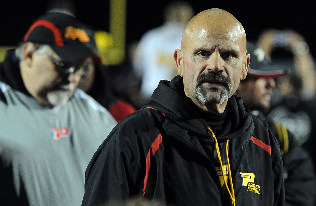 . Paraclete head coach Norm Dahlia talks to his team after losing to San Dimas 20-14 a CIF-SS Mid-Valley Division championship football game at San Dimas High School in San Dimas, Calif., on Friday, Dec. 6, 2013.   (Keith Birmingham Pasadena Star-News)
