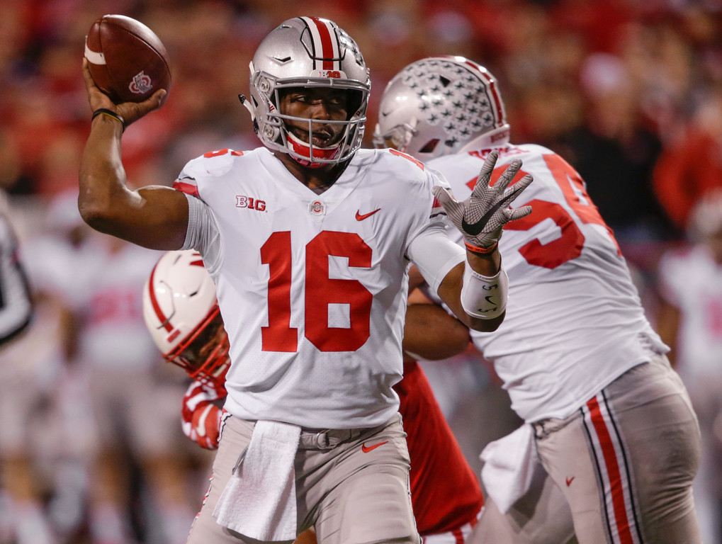 . Ohio State quarterback J.T. Barrett (16) throws as offensive lineman Billy Price (54) blocks Nebraska defensive lineman Deontre Thomas (97) during the first half of an NCAA college football game in Lincoln, Neb., Saturday, Oct. 14, 2017. (AP Photo/Nati Harnik)