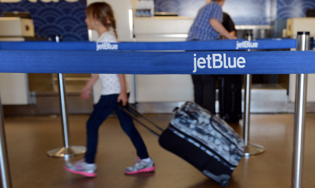 . A girl makes her way up to the jetBlue counter with a bag in tow at the Long Beach Airport August 6, 2013. (Thomas R. Cordova/Staff Photographer)