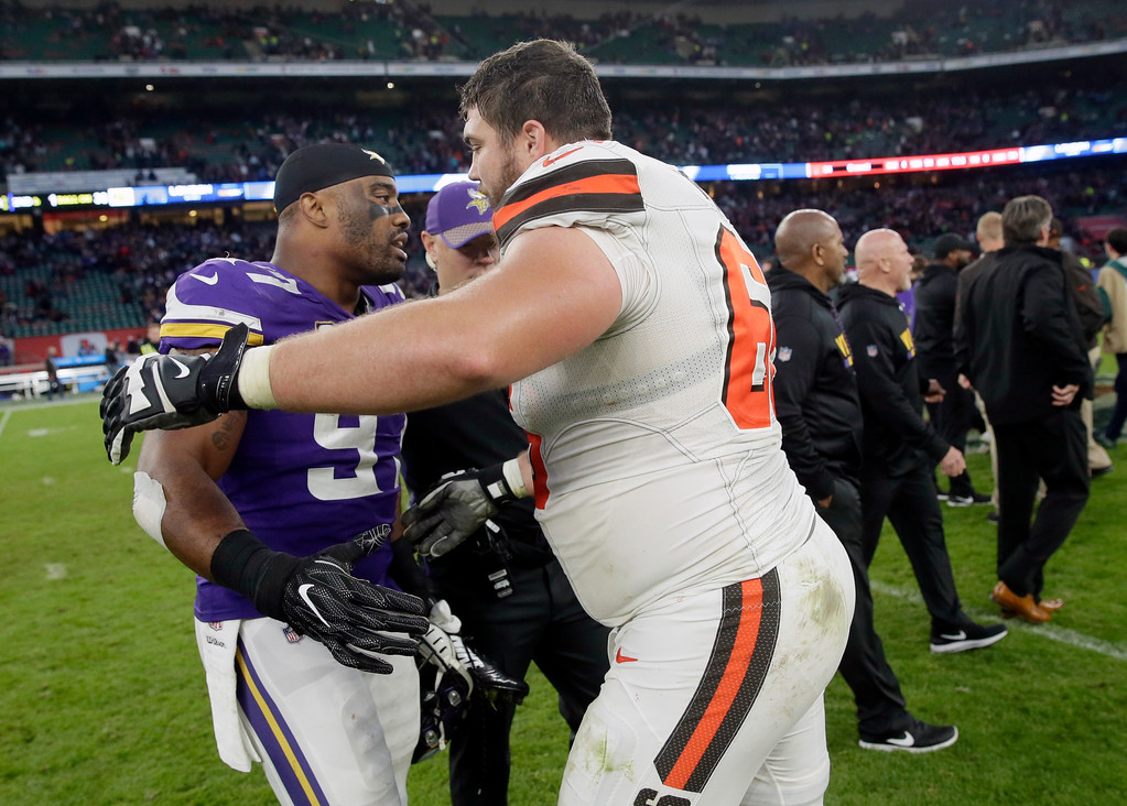 . Cleveland Browns guard Spencer Drango, right, and Minnesota Vikings defensive end Everson Griffen (97) embrace after an NFL football game at Twickenham Stadium in London, Sunday Oct. 29, 2017. The Vikings won 33-16. (AP Photo/Tim Ireland)