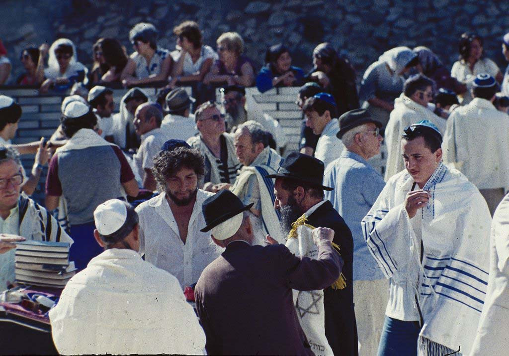 . American folk singer Bob Dylan is shown at the Bar Mitzvah of his son Jesse, right, at the Wailing Wall in Jerusalem, Sept. 20, 1983.  (AP Photo/Zavi Cohen)