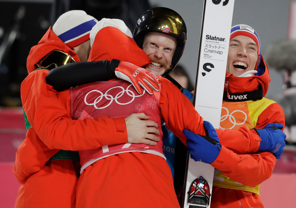 . Norway celebrates after winning the gold medal in the men\'s large hill team ski jumping competition at the 2018 Winter Olympics in Pyeongchang, South Korea, Monday, Feb. 19, 2018. (AP Photo/Matthias Schrader)