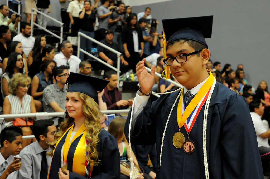 . Salutatorian Bronte Schmit and Valedictorian Steven Salazar enter the gym at the Northridge Academy High School graduation ceremony on Thursday, June 5, 2014. (Photo by Dean Musgrove/Los Angeles Daily News)