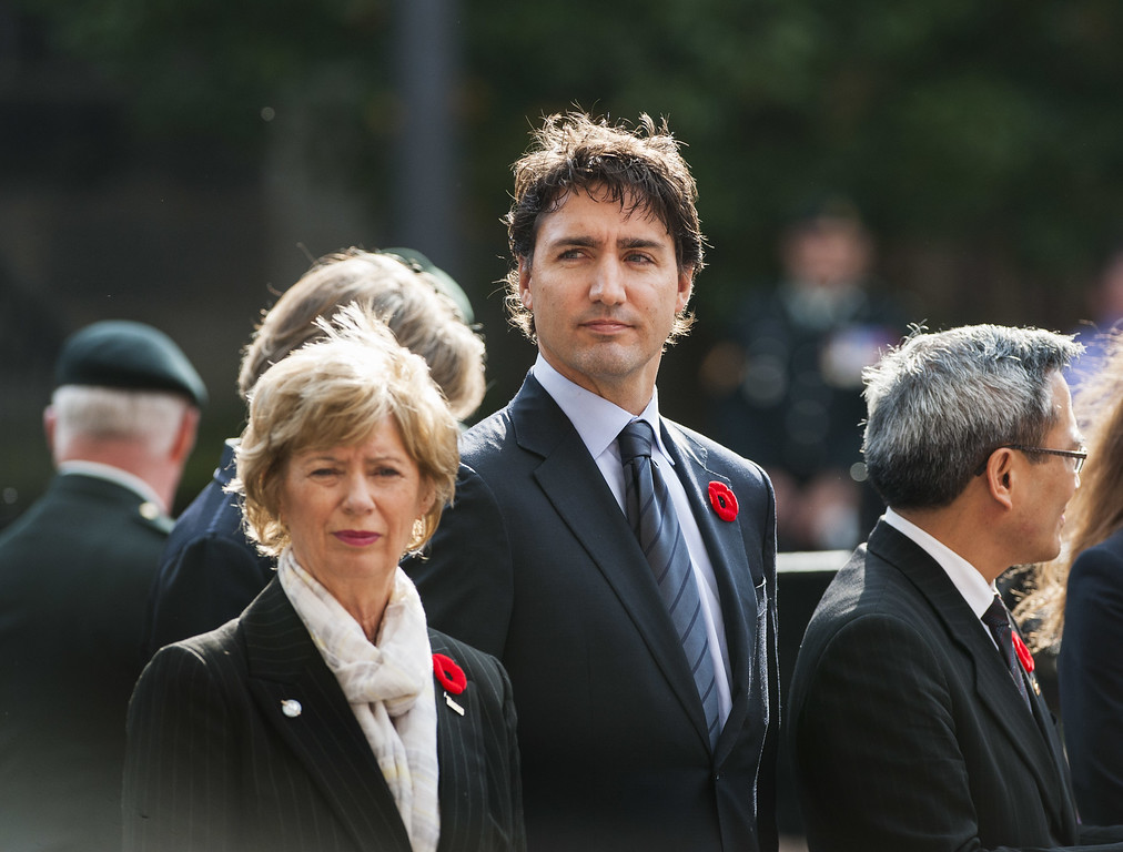 . Hamilton, CANADA- October 28:  Leader of the Liberal Party of Canada Justin Trudeau (C) stands at the funeral procession for Cpl. Nathan Cirillo at the Christ\'s Church Cathedral on October 28, 2014 in Hamilton, Ontario, Canada.   (Photo by Aaron Vincent Elkaim/Getty Images)