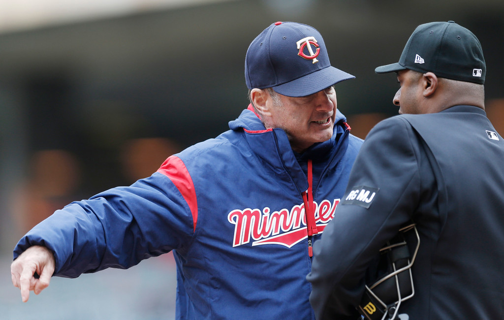 . Minnesota Twins manager Paul Molitor, left, argues with plate umpire Alan Porter after he was ejected for questioning a call on Jason Castro in the eighth inning of a baseball game against the Cleveland Indians, Thursday, April 20, 2017, in Minneapolis. The Indians won 6-2. (AP Photo/Jim Mone)