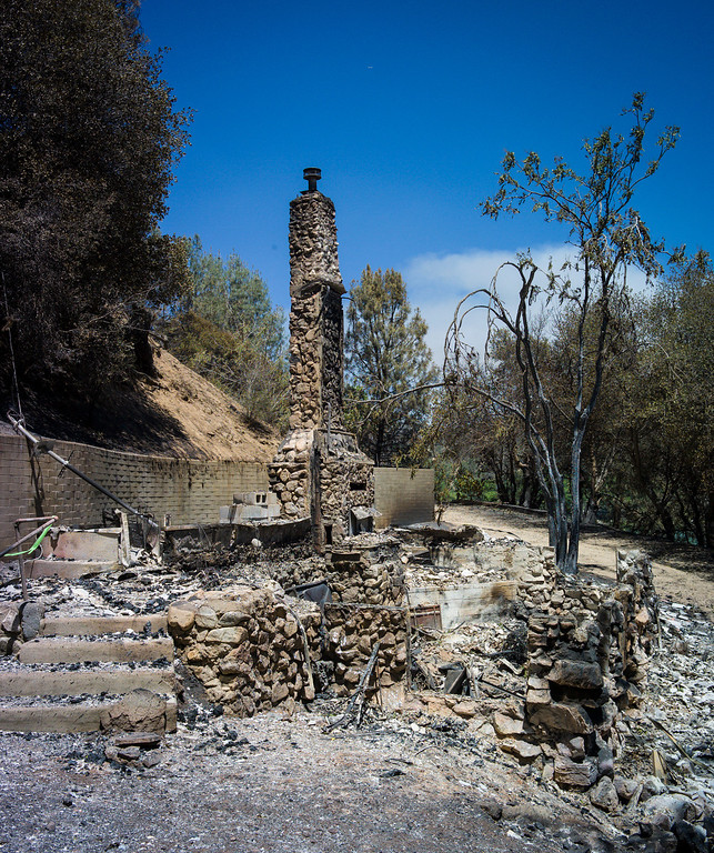 . One of five homes destroyed along East Lake Shore drive next to Lake Hughes lies in rubble.  The Power House fire continued to burn in an area mort of Santa Clarita Monday.   Photo by David Crane/Los Angeles Daily News