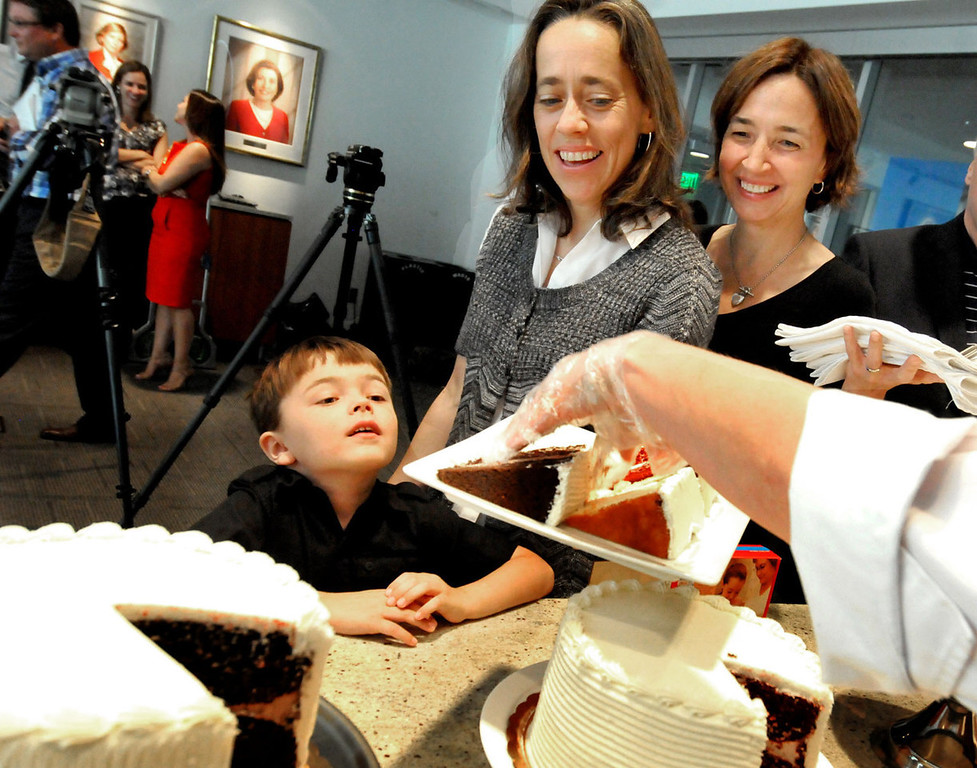 . Louie ten Broeke, 5, watches as his plate is piled with cake as his two moms, Margaret Miles, left, and Cathy ten Broeke, wait their turn o taste-test cakes. The longtime partners will be the first gay couple to be legally married in Minneapolis. (Pioneer Press: John Doman)