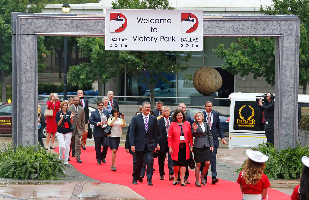 . The Republican National Committee site selection committee arrives along a red carpet laid through the plaza outside the American Airlines Center, as they are courted by the city for the 2016 national convention, on Thursday, June 12, 2014.  (Louis DeLuca/Dallas Morning News)