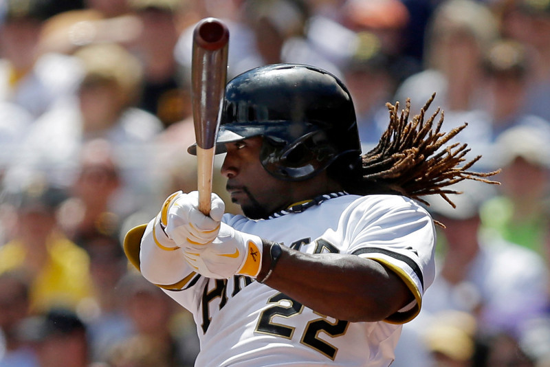 . Pittsburgh Pirates\' Andrew McCutchen (22)  singles off Colorado Rockies starting pitcher Juan Nicasio (12) in the third inning of an MLB National league baseball game in Pittsburgh Sunday, Aug. 4, 2013. (AP Photo/Gene J. Puskar)