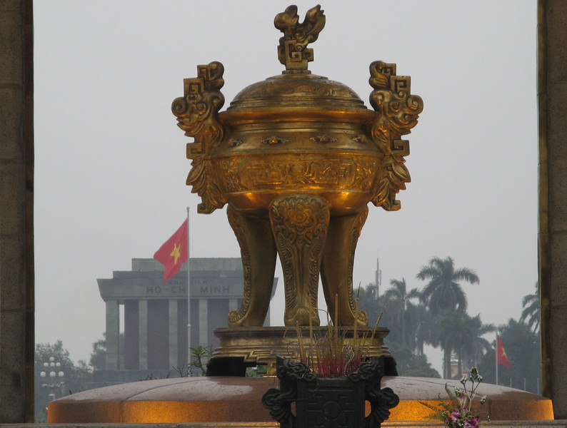 A memorial with Ho Chi Minh's mausoleum in the background.