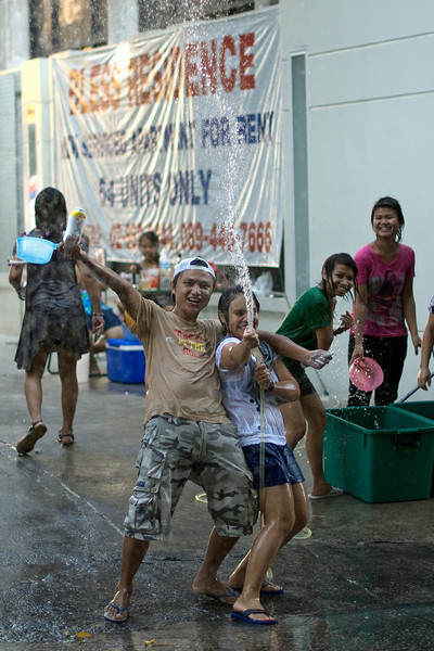 Locals playing around with water during the Songkran Festival in Thailand