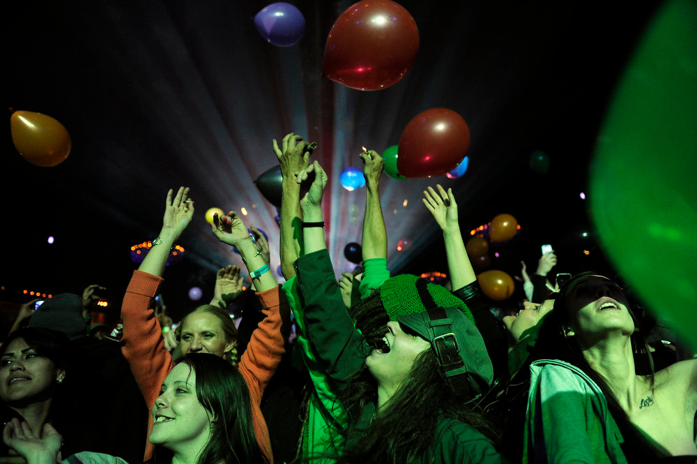 """. Fans leap to catch balloons dropped at midnight to celebrate 4/20 during DJ Snoopalicious\', aka Snoop Lion, DJ set on Friday, April 19, 2013 at the Fillmore Auditorium in Denver. Snoop also presented his documentary Reincarnated at the first ever \""""Green Carpet\"""" event as a part of the High Times Cannabis Cup. Seth A. McConnell, The Denver Post"""