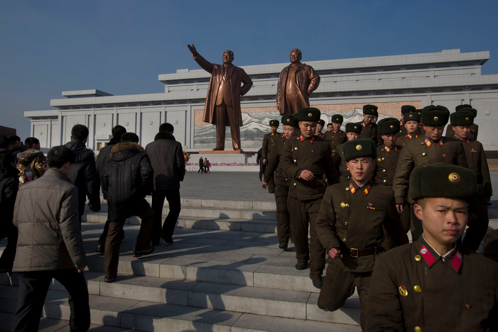 Description of . North Korean soldiers and others gather in front of bronze statues of the late leaders Kim Il Sung and Kim Jong Il to pay their respects in Pyongyang, North Korea on Saturday, Feb. 16, 2013. North Koreans turned out to commemorate what would have been the 71th birthday of Kim Jong Il who died on Dec. 17, 2011. (AP Photo/David Guttenfelder)