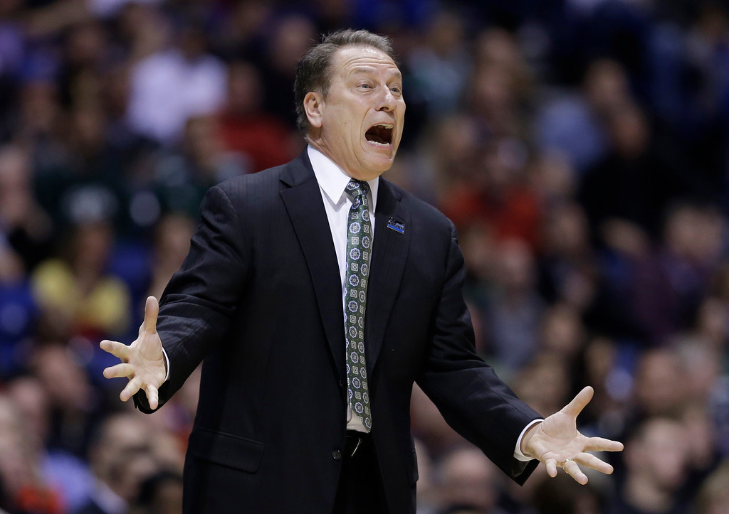 . Michigan State head coach Tom Izzo reacts as he directs his team during the first half of a regional semifinal against Duke in the NCAA college basketball tournament, Friday, March 29, 2013, in Indianapolis. (AP Photo/Darron Cummings)