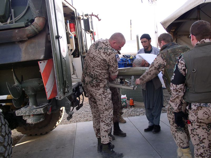 I helped a physician from RBH get her father care. He had a heart attack and there is no diagnostic evaluation available. Suffering from chest pain, we got him into an ambulance (Kabul Ambulance - no O2) , transported to ISAF ER (for soldiers mainly). There he got appropriate labs, pain control, an ECHO and diagnosis. Here he is being re-loaded into an ambulance for return to Kabul. See next picture for more.