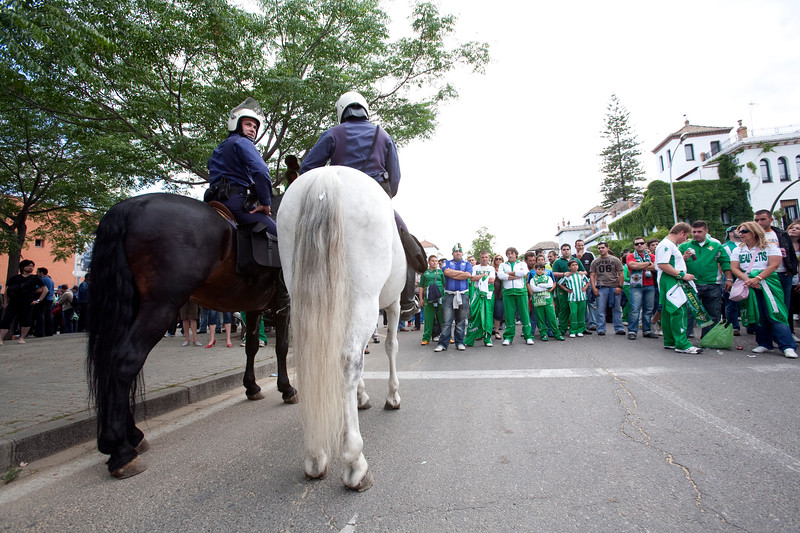 Policemen watching outside the stadium. Taken before the local derby between Real Betis and Sevilla FC which took place at Ruiz de Lopera stadium, Seville, Spain, on 11 May 2008.