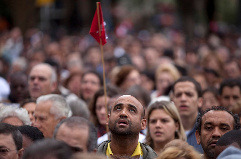 . People attend a Catholic Mass celebrating Corpus Christi outside the Sao Paulo Metropolitan Cathedral in Sao Paulo, Brazil, Thursday, May 30, 2013.  The event is dedicated to the mystery of the Eucharist and concludes the cycle of feasts following Easter. (AP Photo/Andre Penner)