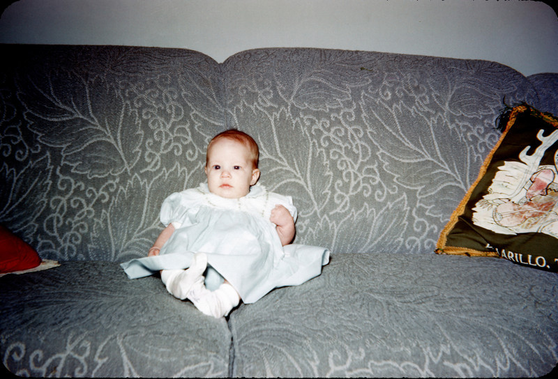 baby susan on couch with amarillo pillow.jpg