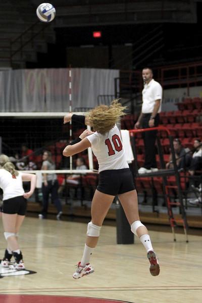 Molly Rhyne, 10, serves the ball.