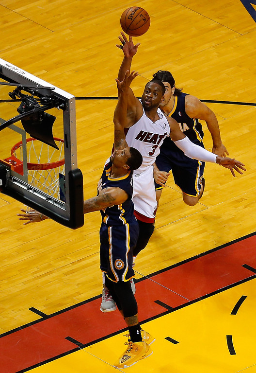 . Dwyane Wade #3 of the Miami Heat takes a shot over George Hill #3 of the Indiana Pacers during Game Four of the Eastern Conference Finals of the 2014 NBA Playoffs at American Airlines Arena on May 26, 2014 in Miami, Florida.  (Photo by Chris Trotman/Getty Images)