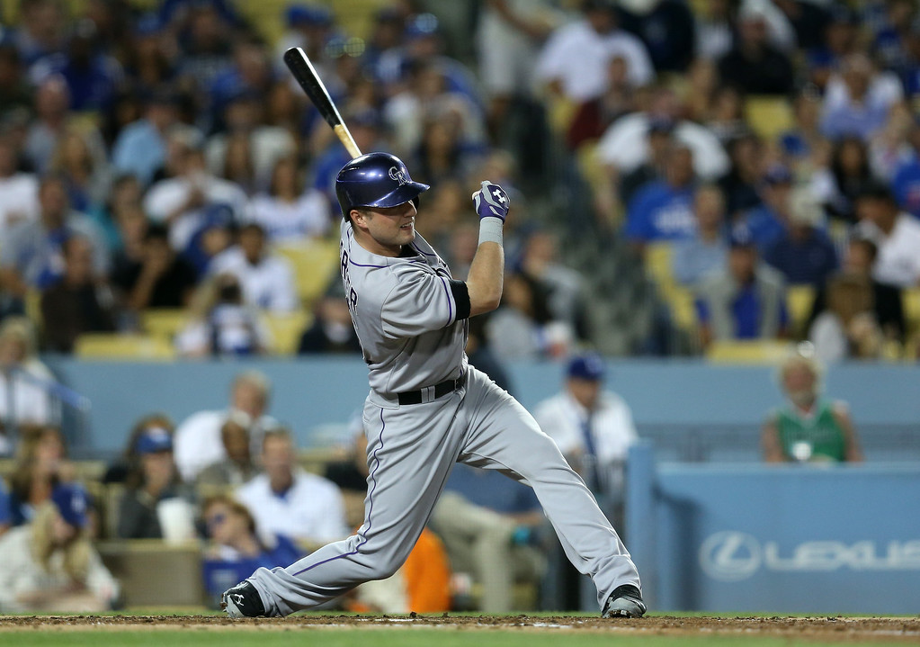 . Kyle Parker #16 of the Colorado Rockies hits an RBI ground rule double over the center field wall in the fourth inning against the Los Angeles Dodgers at Dodger Stadium on September 27, 2014 in Los Angeles, California.  (Photo by Stephen Dunn/Getty Images)