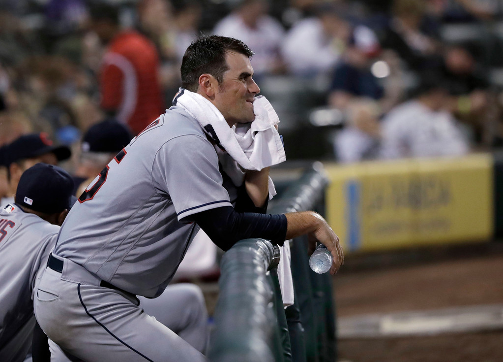 . Cleveland Indians starting pitcher Adam Plutko rests on the dugout rail after being pulled in the fifth inning of the team\'s baseball game against the Chicago White Sox on Tuesday, June 12, 2018, in Chicago. (AP Photo/Charles Rex Arbogast)