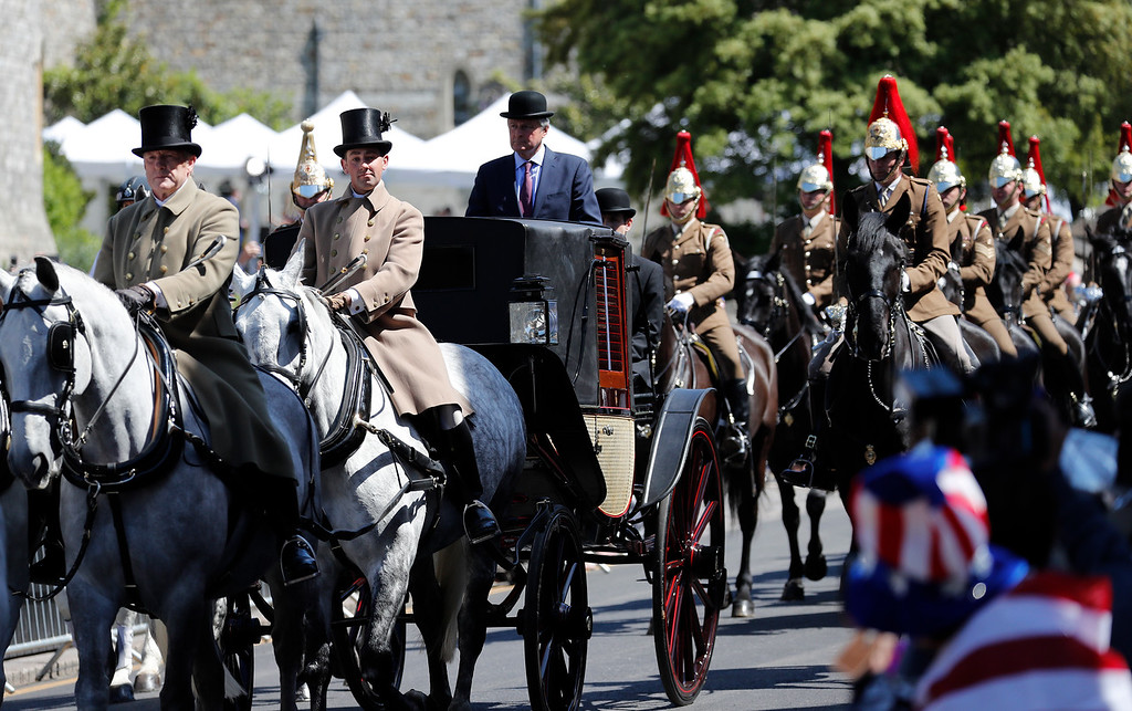 . A carriage is driven through the streets of Windsor, England during a rehearsal for the procession of the upcoming wedding of Britain\'s Prince Harry and Meghan Markle, Thursday, May 17, 2018. Preparations are being made in the town ahead of the wedding of Britain\'s Prince Harry and Meghan Markle that will take place in Windsor on Saturday May 19.(AP Photo/Frank Augstein)