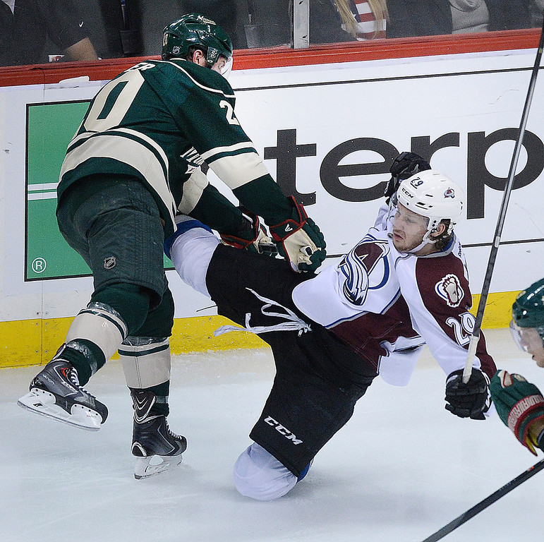 . Minnesota defenseman Ryan Suter (20) knocked Colorado center Nathan MacKinnon (29) to the ice in the second period.  (Photo by Karl Gehring/The Denver Post)