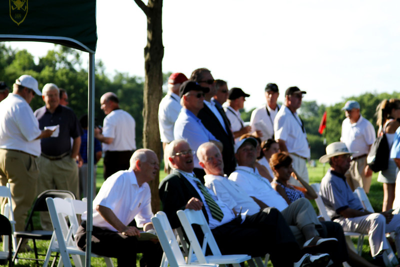 WGA Directors and spectators look over the 18th green on Thursday.