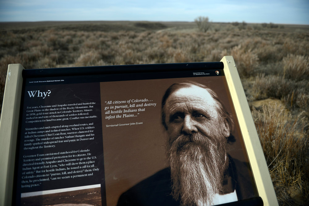 """. A descriptive sign with a picture of Colorado Territorial Governor, John Evans, greets visitors of the Sand Creek Massacre National Historic site with a quote of \""""All citizens of Colorado...go in pursuit, kill and destroy all hostile indians that infest the plains...\""""  On November 29th, 1864, Colorado militiamen killed over 150 Cheyenne and Arapaho Indians at the site who were living peacefully along the creek in their village. The Denver Post/ Andy Cross"""