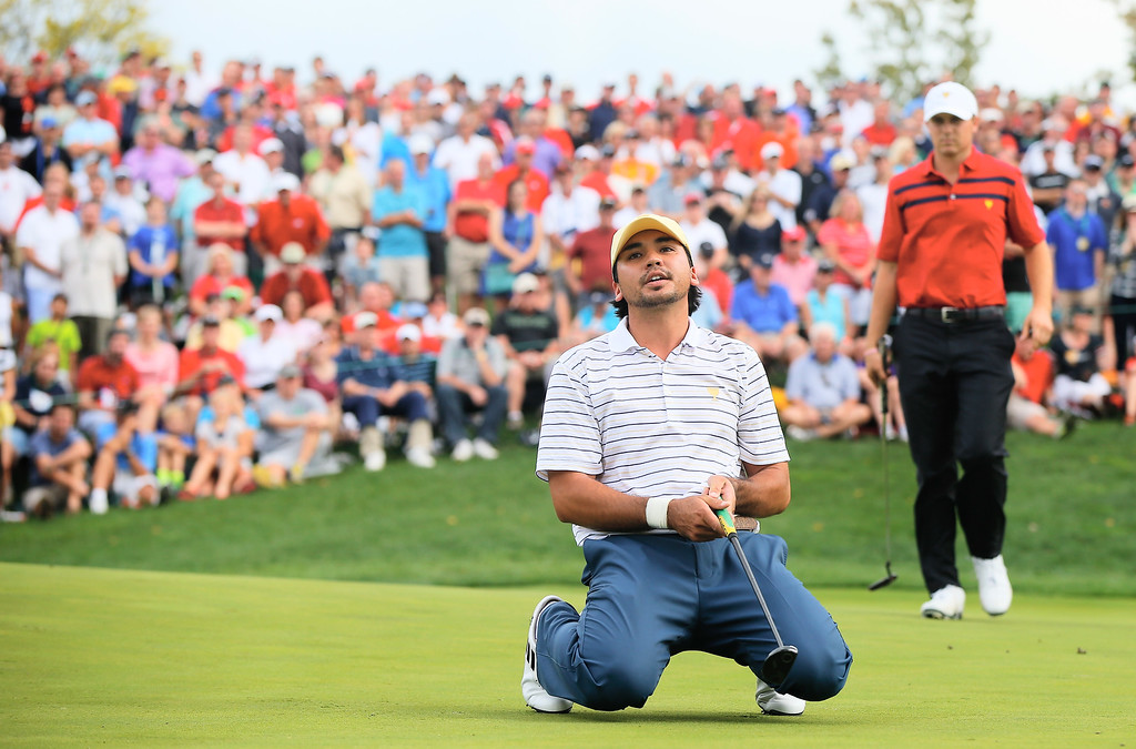 . DUBLIN, OH - OCTOBER 05:  Jason Day of Australia  and the International Team reacts to a missed birdie putt on the 17th green as Jordan Spieth of the U.S.  looks on during the Day Three Four-ball Matches at the Muirfield Village Golf Club on October 5, 2013  in Dublin, Ohio.  (Photo by Matt Sullivan/Getty Images)